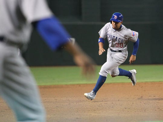 Cubs baserunner Jon Jay scores a run in the second inning against the Diamondbacks on Friday.
