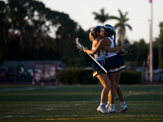 Naples sophomore, Mia Longmire, hugs her teammate after scoring a goal during the regional semifinal game against Saint Stephen's Episcopal on Monday, April 30, 2018 at Naples High School.