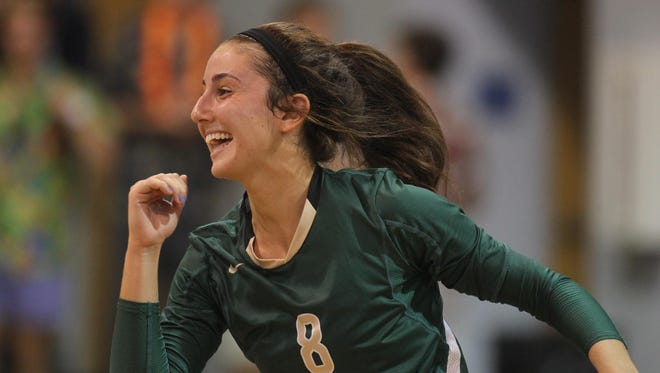 Lincoln senior Madison Fitzpatrick celebrates a point during the Trojans' rally from down 2-0 against Maclay on Thursday night to win 3-2.
