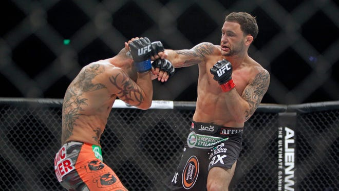 Frankie Edgar, right, lands a punch against Cub Swanson in November.