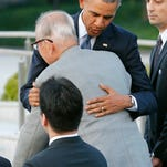 U.S. President Barack Obama hugs Shigeaki Mori, an atomic bomb survivor and a creator of the memorial for American WWII POWs killed in Hiroshima, during a ceremony at Hiroshima Peace Memorial Park in Hiroshima, western, Japan, Friday, May 27, 2016. Obama on Friday became the first sitting U.S. president to visit the site of the world's first atomic bomb attack, bringing global attention both to survivors and to his unfulfilled vision of a world without nuclear weapons