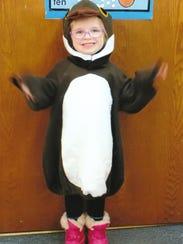 Norah models a killdeer costume at St. John Lutheran