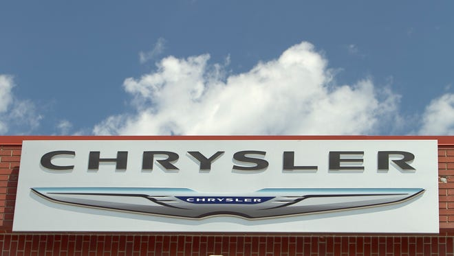 The Chrysler logo is displayed at a car dealership in Omaha. Fiat Chrysler Automobiles will begin to reward hackers who expose deficiencies in car software.