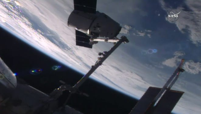 In this frame from NASA TV, the SpaceX Dragon capsule arrives at the International Space Station bearing supplies on Wednesday, July 20, 2016. The shipment includes a docking port needed for future rocket ships.