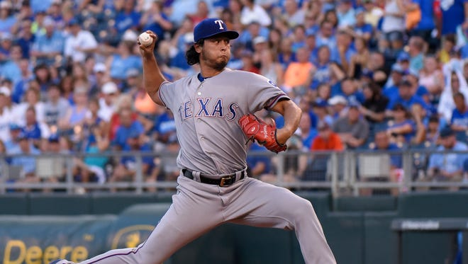 Yu Darvish #11 of the Texas Rangers throws in the second inning against the Kansas City Royals at Kauffman Stadium on July 22, 2016 in Kansas City, Missouri.