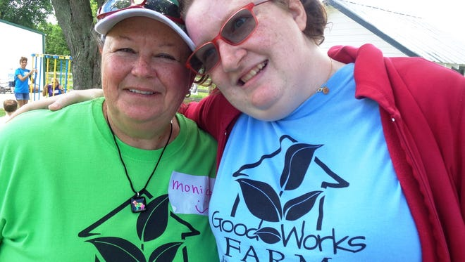 Monica Janning with special needs camper Emily during the Good Works Farm autism enrichment camp June 18-22 on her Homestead Farm in Bellbrook, Ohio.