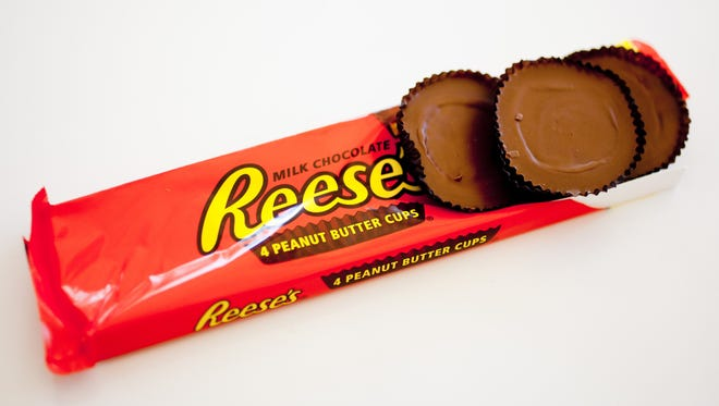 Reeses Peanut Butter Cups are among the best candy handouts you can drop into little plastic pumpkins on Halloween.