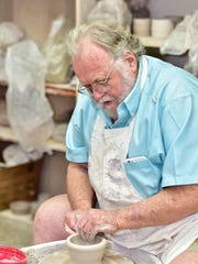 Pensacola State visual arts professor, Bill Clover works on pottery for the Pick a Bowl for Manna event.