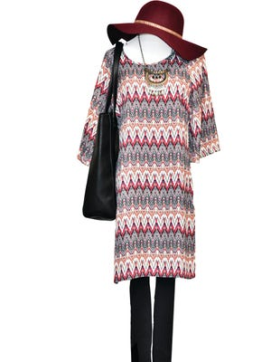 A heavier material, burgundy Aztec hat, $58, paired with the Aztec embossed sleek black tote, $68, black leggings and the Skies Are Blue tunic dress, $54, tranfsorms the outfit for cooler days,