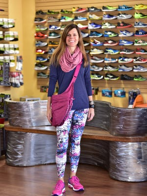 """Shannon Kohler wearing a Brooks long sleeve distance shirt, $49.99; Dona Jo """"paulista"""" tights, $71.99; Mizuno Wake Rider shoes, $120.00; Oiselle Lux Runfinity deep rose bag, $37.99 and Apera yoga tote, $119; at Running Wild."""
