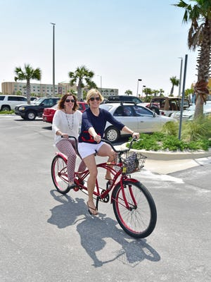 Kelly MacLeod and Heather Grant brave the tandem bike.