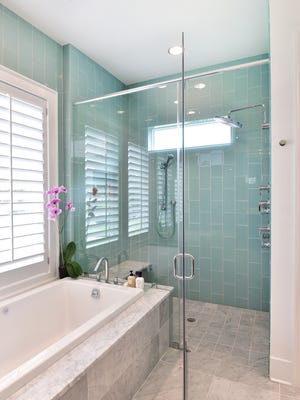 Crisp, clean lines and soothing colors create a relaxing bath space.