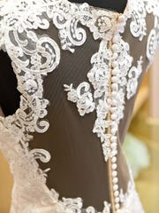 The back of a wedding dress on display Wednesday, Jan.