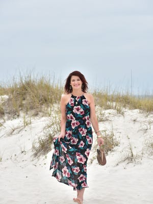 Alison Westmoreland, location Pensacola Beach.Francesca's dress; Michael Kors watch; Sam Edelman sandals; locket, Jeweler's Trade; MantraBand bracelets.