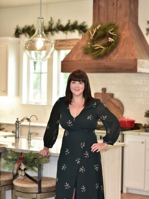 Ashley Morgan previews her kitchen for the St. Christopher's Christmas Caravan.