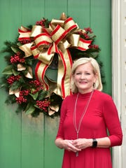 Patti Thomas previews her elegant wreath prior to the St. Christopher's Christmas Caravan.