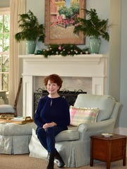 Lacy Sweeney previews her mantle decor before the St. Christopher's Christmas Caravan.