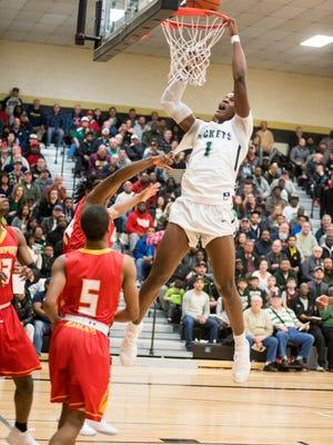 New Haven High School forward Romeo Weems dunks the ball during the MHSAA Class B basketball quarterfinals against Bridgeport High School at Corunna High School March 20.