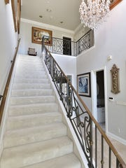 11 La Caribe, the staircase and grand chandelier.