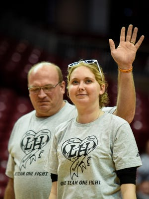 Lauren Hill walks off the court at the end of her speech, looking out and over the crowd that came to watch the game and hear her message.