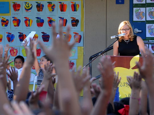 Diana Vides, principal at Piru Elementary School, asks her students Thursday, who wanted a new iPad. All the students raised their hand.