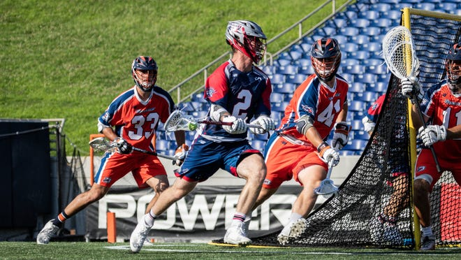 Bryce Wasserman of the Boston Cannons looks for an opening while being guarded by Matt Whitcher (No. 33) and Mark Evanchick (No. 41) of the Philadelhia Barrage during Major League Lacrosse action in Annapolis, Maryland on July 21, 2020. Photo courtesy of Anne Evans