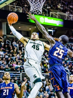 Denzel Valentine and MSU struggled at home against Illinois and Illini stars Kendrick Nunn (25) and Malcolm Hill (21) on Feb. 7 last year. The 59-54 loss was MSU's last stumble before a mid-February run showed signs of what the Spartans would become in the postseason.