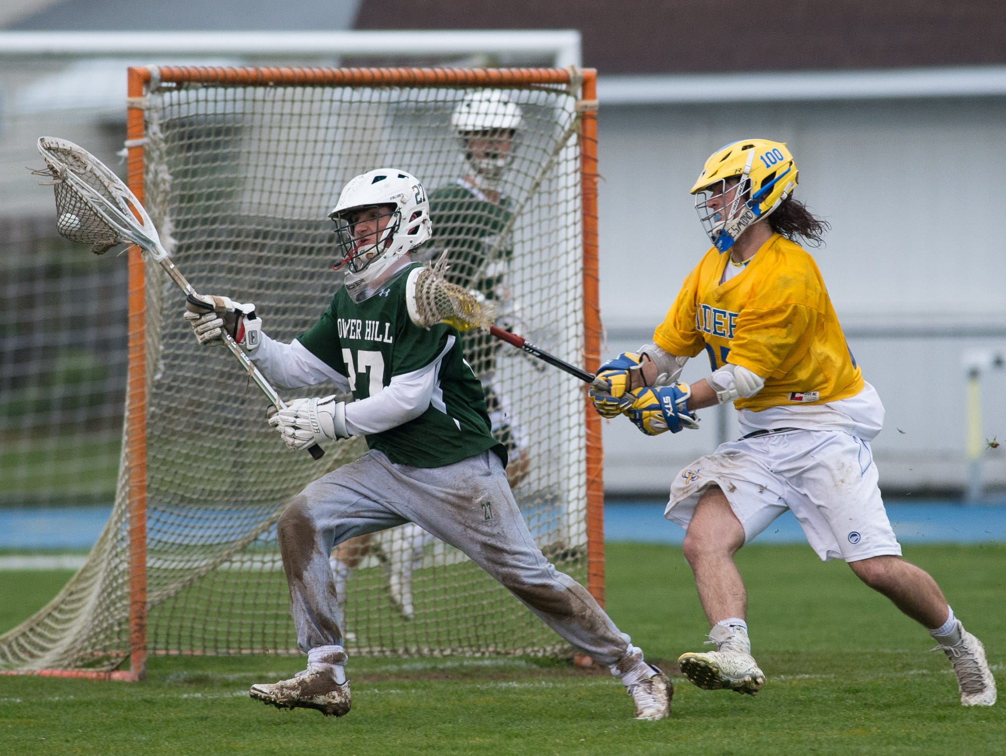 Tower Hill's goalie Michael Gianforcaro (27) keeps the ball away from Caesar Rodney's offense in their 11-9 win.