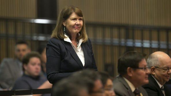 Rep. Ann Kirkpatrick, D-Ariz., stands after testifying