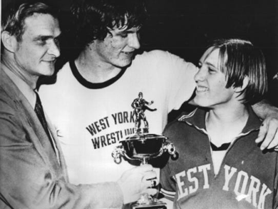 West York's Don Lehman, center, and Kevin McCleary