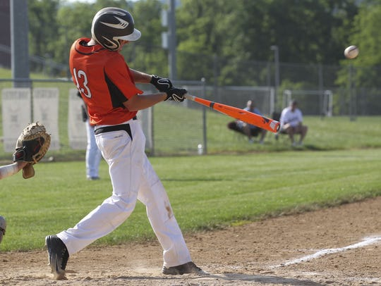 Palmyra's Dylan Spagnolo lifts a sacrifice fly in the