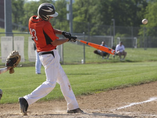 Palmyra's Dylan Spagnolo lifts a sacrifice fly in the fifth inning to score the only run of the Cougars' 1-0 win over Bishop McDevitt in the District Three Class AAA tournament semifinal game at Northern High School in Dillsburg.