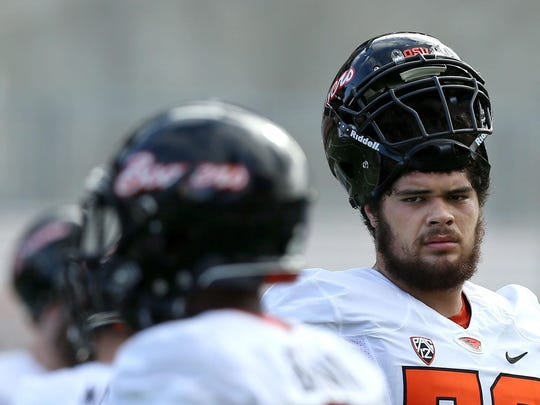 Oregon State center Isaac Seumalo looks on during the first day of fall practice on Saturday, Aug. 8, 2015, in Corvallis, Ore.