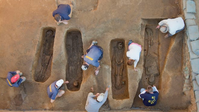 Overview of the chancel burial excavations. Archaeologists (from left to right) Mary Anna Richardson, Danny Schmidt, David Givens, Dan Smith, Don Warmke, Jamie May, Dan Gamble, and Dr. William Kelso. Photo by Michael Lavin,