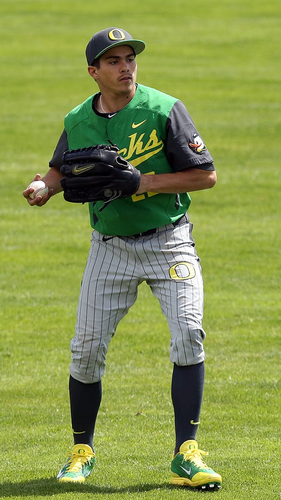 Oregon's Austin Grebeck throws infield against Oregon State at Goss Stadium in Corvallis Sunday April 27, 2014.