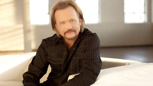 Country artist Travis Tritt performs a solo acoustic