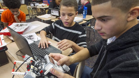 Students work with robots at Ferguson K-8 School in