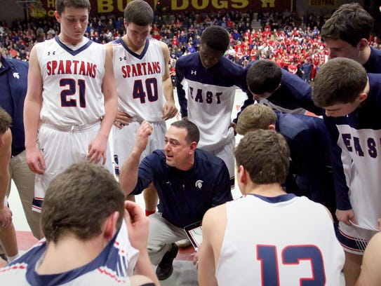 Brookfield East's Coach Joe Rux calls a timeout to
