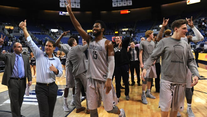 Nevada celebrates their victory over San Diego State at Lawlor Events Center on Wednesday.