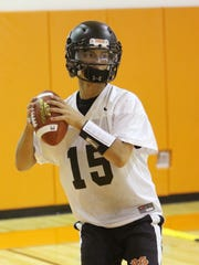 Marlboro High School's Paul Evans gets ready to pass the ball during football practice on Wednesday.