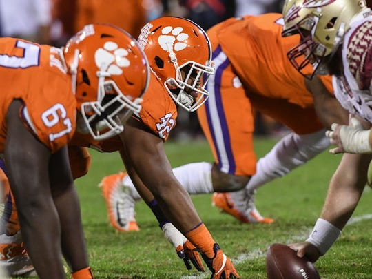 Clemson defensive tackle Albert Huggins (67), left, and defensive tackle Christian Wilkins (42) line up against Florida State during the fourth quarter in Memorial Stadium at Clemson on Saturday.