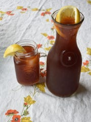 Peachy iced tea with bourbon is a refreshing summer