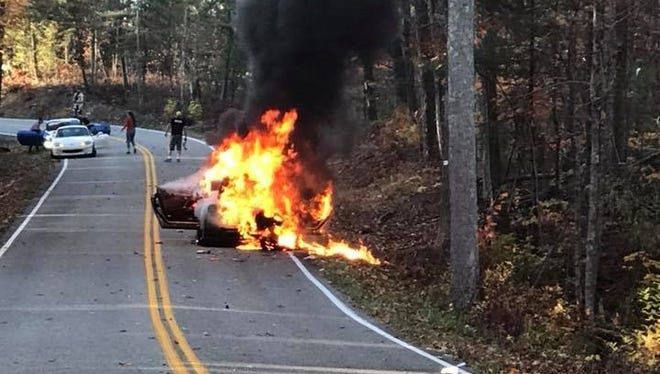 """A 2017 Nissan GT-R (possibly Nismo) burns on a stretch of U.S. Highway 129 known as """"The Dragon"""" on Sunday, Nov. 5, 2017."""