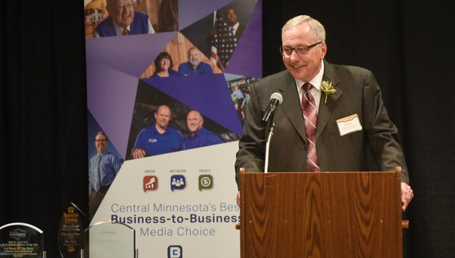 Anderson Trucking Services CEO Rollie Anderson accepts the 2018 Family Owned Business of the Year Award during the annual St. Cloud Area Chamber of Commerce Business Awards Luncheon Tuesday, May 8, in St. Cloud.