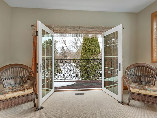 French doors off the master open to a balcony enclosed