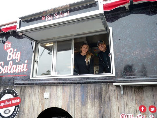 "Sarah King, Manager, and Mike LaPenta, Owner of Casapulla's Subs in Rehoboth pose for a photo in there new food truck ""Big Salami"" on Monday, Jan. 29, 2018."