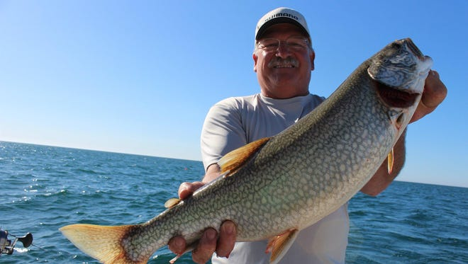 """On the Best Chance, Too out of Saugatuck, charter operator Dave Engel says the lakes may have fewer salmon than in the past because of changing lake conditions, but """"the lake trout fishing has never been better."""""""