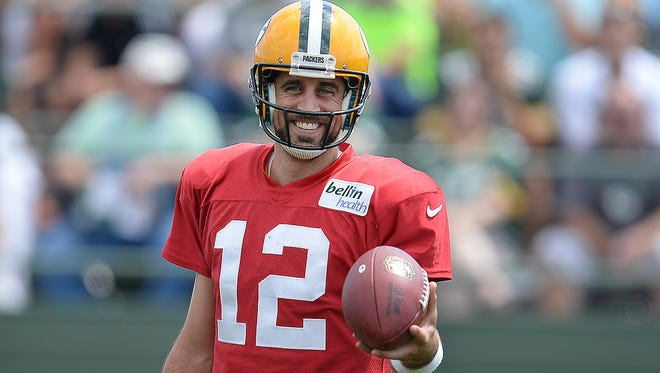 Quarterback Aaron Rodgers (12) smiles during Green Bay Packers Training Camp at Ray Nitschke Field August 10, 2015.