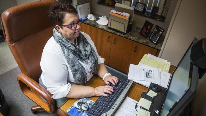 Judge Kimberly Dowling works in her office in the Justice Center.