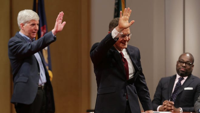 Republican Gov. Rick Snyder, left, and Democratic challenger Mark Schauer wave good-bye after a town hall forum at Wayne State University  in Detroit Oct. 12. Undecided voters will be the key to who wins in the Nov. 4 election.